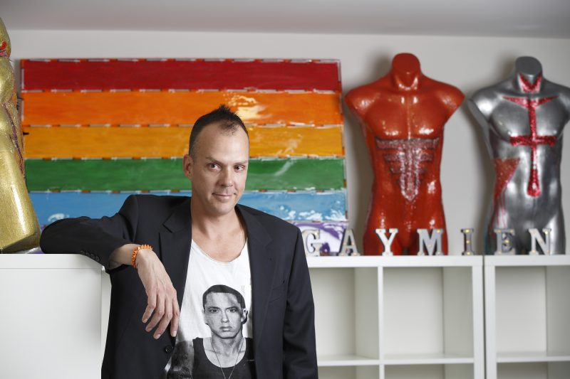 Damien Chandler pictured in front of his artwork