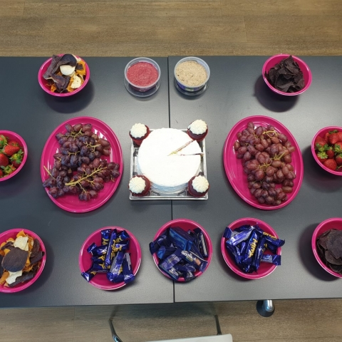 An assortment of snack food on a table.