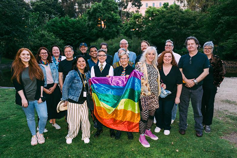 VincentCare staff holding a rainbow flag